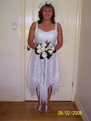 Jodie looking gorgeous in a white lace wispy cami fairy dress